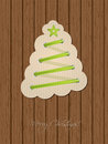 Christmas greeting with shoe lace tree and wooden background card design green Stock Image