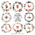 Christmas greeting wreaths with calligraphy. Hand drawn elements.