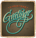 Christmas greetings hand lettered vintage card with lettering handmade calligraphy and with grunge effect Royalty Free Stock Image