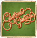 Christmas greetings hand lettered vintage card with lettering handmade calligraphy and with grunge effect Royalty Free Stock Photos