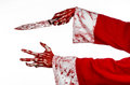 Christmas and halloween theme santa s bloody hands of a madman holding a bloody knife on an isolated white background studio Royalty Free Stock Photos