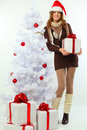 Christmas - happy girl with gift and snow fir Stock Photos