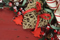 Christmas and Happy Holiday background on dark red vintage recycled wood - closeup. Royalty Free Stock Photo