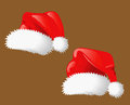 Christmas hats of Santa Claus Stock Images