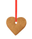 Christmas heart cookie on red ribbon isolated on white Royalty Free Stock Photo