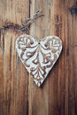 Christmas heart rustic on a wooden background Royalty Free Stock Photo