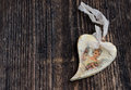 Christmas heart wooden handmade or on the old wooden background Royalty Free Stock Images