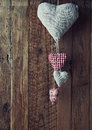 Christmas hearts handmade on a wooden wall Royalty Free Stock Photos