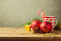 Christmas holiday background with checked cup and decorations over blur dreamy background