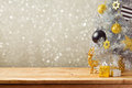 Christmas holiday background with Christmas tree and decorations on wooden table. Black, golden and silver ornaments Royalty Free Stock Photo