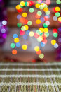 Christmas holiday background with empty wooden deck table over festive bokeh ready for product montage Royalty Free Stock Photos