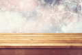 Christmas holiday background with empty wooden deck table over winter bokeh. Ready for product montage Royalty Free Stock Photo