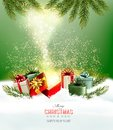 Christmas holiday background with presents and magic box. Royalty Free Stock Photo