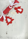Christmas holiday background with red and white theme handmade fabric bon bon cracker vertical festive felt decorations on vintage Stock Images