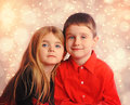 Christmas holiday children with lights two are posing for a portrait golden in the background Royalty Free Stock Image