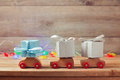 Christmas holiday concept with gift boxes on toy cars wooden Royalty Free Stock Photo