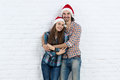 Christmas Holiday Happy Couple Wear New Year Santa Hat Cap, Man And Woman Love Smile Embracing Royalty Free Stock Photo