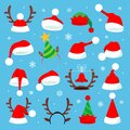 Christmas holiday hat. Funny 3d elf, snow reindeer and Santa Claus hats for noel. Royalty Free Stock Photo