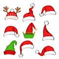 Christmas holiday hat. Funny elf, snow reindeer and Santa Claus hats wearing for noel sign. Elves fur cap clothes, decoration xmas Royalty Free Stock Photo
