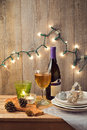 Christmas holiday table setting with candles and Christmas lights Royalty Free Stock Photo