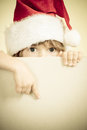 Christmas holidays concept child dressed in santa claus with paper blank copy space for your text retro toned image Stock Photo