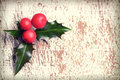 Christmas holly with red berries on wooden background Royalty Free Stock Photos