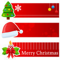 Christmas horizontal banners a collection of three with a traditional tree with baubles a santa claus hat and a decorated candle Stock Image