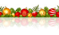 Christmas horizontal seamless background with red and gold balls. Vector illustration.