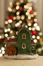 Christmas house miniature with tree blur background Stock Images