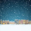 Christmas house in snowfall at the night. Happy holiday greeting card with town skyline, flying Santa Claus and deer