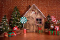 Christmas interior with wooden house, candy, tree and gifts. No people. Holiday background Royalty Free Stock Photo