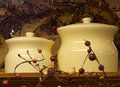 Christmas jars two ceramic containers set within a viny decorative trellis Stock Photo