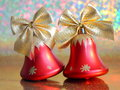 Christmas jingle bells red stock photo ornaments on blurred background Royalty Free Stock Images