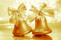 Christmas jingle bells stock photos gold ornaments on blurred background Royalty Free Stock Images