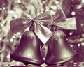 Christmas jingle bells stock photos silver ornaments on blurred background Royalty Free Stock Image