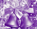 Christmas jingle bells stock photos silver ornaments on blurred background Royalty Free Stock Photography