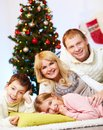 Christmas joy portrait of four happy family members at home on eve Stock Photo