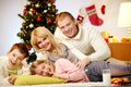Christmas joy portrait of four happy family members at home on eve Royalty Free Stock Photo
