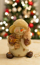 Christmas joy snowman with tree bokeh in the background Stock Photo