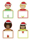 Christmas kids holding signs Royalty Free Stock Photography