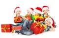 Christmas helpers kids in Santa hat holding presen Royalty Free Stock Photo