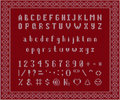 Christmas knitted font. Latin Alphabet on seamless background