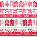 Christmas knitted seamless pattern with town houses adn snowflakes winter red background scandynavian city kntting style Stock Images