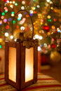 Christmas lantern with magic warm lights in the background lovely wooden magical bokeh of tree Royalty Free Stock Photos
