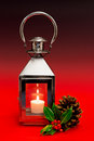 Christmas lantern red background with holly and cone on a graduated Stock Photos