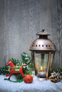 Christmas lantern in the snow background with burning Stock Photo