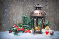 Christmas lantern in the snow background with burning Stock Photos