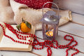 Christmas Lanterns, mandarin , red beads on wooden background. Royalty Free Stock Photo