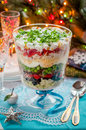 Christmas layered salad in a trifle bowl Stock Images
