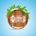 Christmas lettering on round wood border with snowy fir tree branch and cones blue background Royalty Free Stock Images